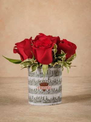 Red Rose Sushi, Frida's best seller. Bouquet of red roses wrapped in paper with a musical note design.